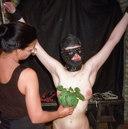 stinging her titties with nettle leaves